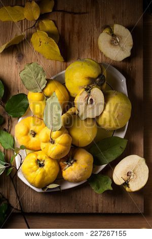 Ripe Large Quince Fruit On A Plate