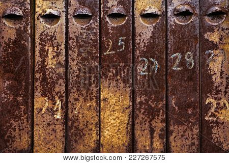 old rusty iron mailboxes.