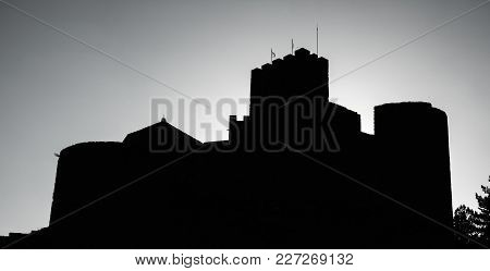 Dark High Contrast Profile Of Medieval Castle Of Loarre On Top Of Hill At Sunset