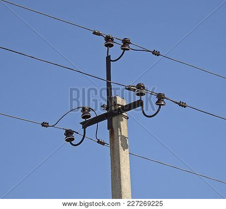 Metal electric pole and high viltage power lines. New electric pillar.High voltage poles. Power line. Power line background.