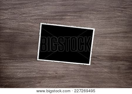 Blacked Out Old Vintage Photo Template On Rustic Wooden Background