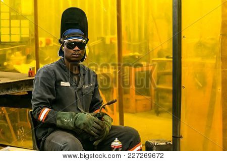 Johannesburg, South Africa, 09/18/2014, Tradesman Working With A Welding Torch In A Workshop