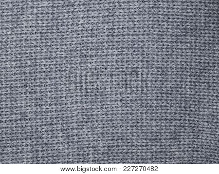 Grey Handmade Knitted Fabric Texture From Above. The Knitted Fabric Texture