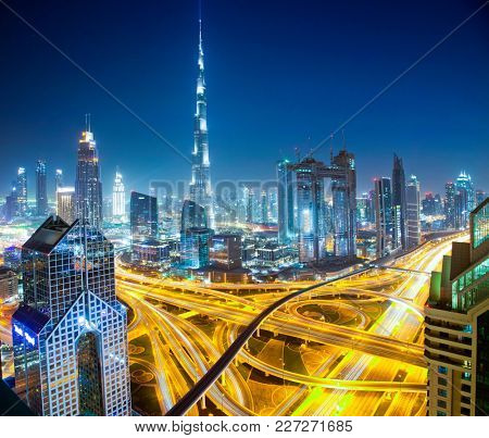 DUBAI, UAE - FEBRUARY 16: Burj Khalifa the tallest building in the world. Dubai Downtown cityscape. Dubai evening skyline, busy Sheikh Zayed road intersection, sunset on February 16, 2018 in Dubai