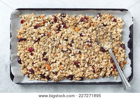 Homemade Granola On Baking Sheet. Table Top View. Concept Of Healthy Eating, Dieting, Healthy Lifest
