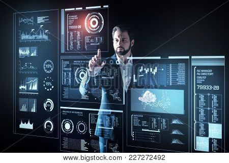 Careful Programmer. Attentive Experienced Smart Programmer Looking Elegant In His Suit While Standin