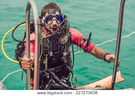 Happy Diver Returns To The Ship After Diving.