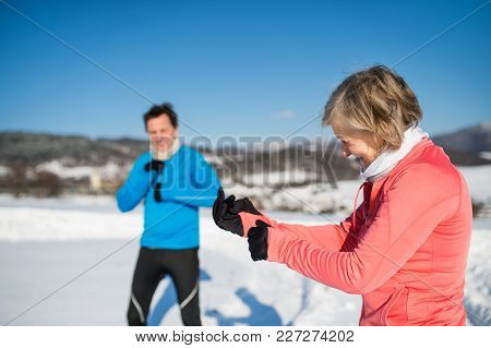Senior Couple Jogging Outside In Winter Nature, Resting.