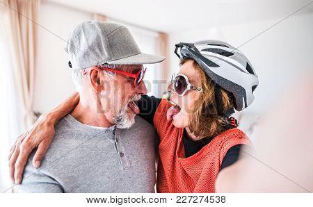 Crazy Senior Couple Having Fun At Home.