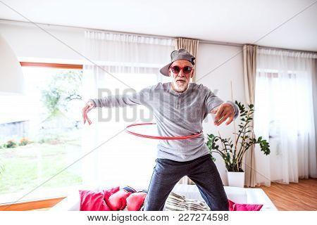 Crazy Senior Man Having Fun At Home.