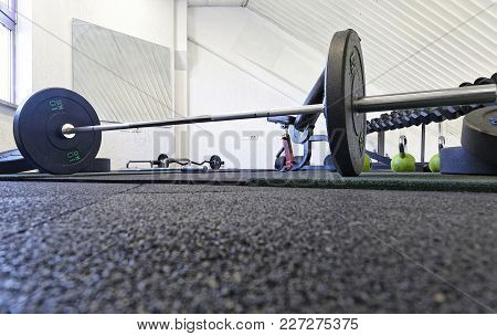 Exercise Weight Equipment In Empty Gym Room
