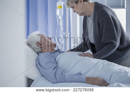 Senior Woman And Dying Husband