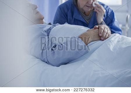 Crying Woman Wiping Tears