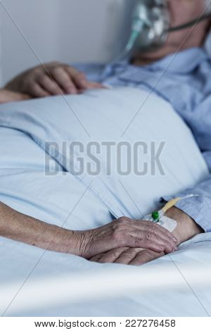 Family Member Comforting Dying Patient