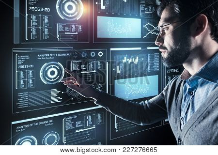 Worried Programmer. Clever Experienced Young Programmer Feeling Worried While Touching The Screen Of