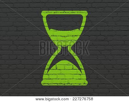 Timeline Concept: Painted Green Hourglass Icon On Black Brick Wall Background