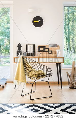 Workspace With Clock And Chair