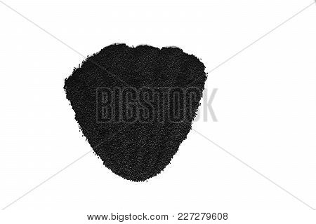 A Layer Of Dry Onion Seeds In The Form Of A Sector On A White Background.