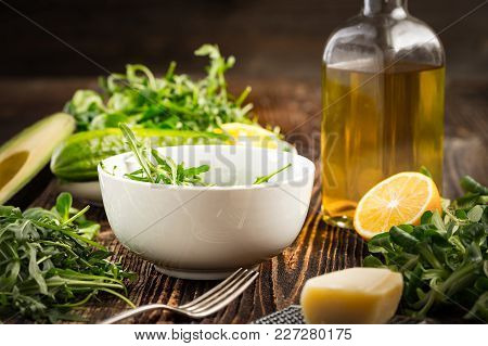 Lettuce And A Bottle Of Olive Oil