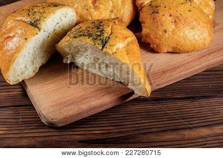 Fresh Bread Ciabatta On Cutting Board On Wooden Table