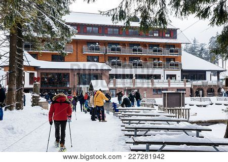 Seebach Mummelsee, Germany - Feb 18, 2018: Winter Day With Snow With People Walking Toward The Resta
