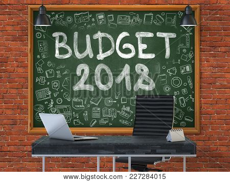 Green Chalkboard With The Text Budget 2018 Hangs On The Red Brick Wall In The Interior Of A Modern O