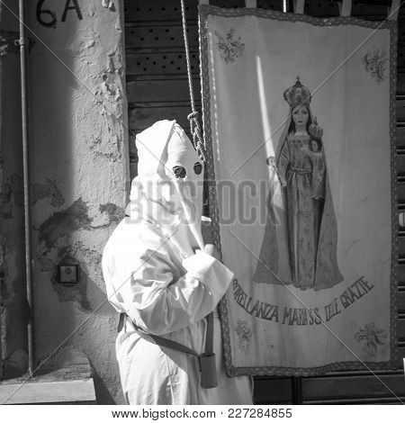 Procession That Takes Place On Easter Friday In Civitavecchia. There Are Men And Women Hooded In Pen