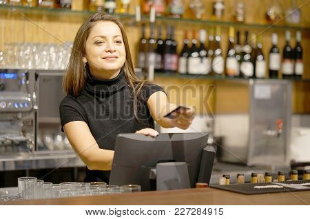 A Restaurant Worker Registrating New Order By Cash-register