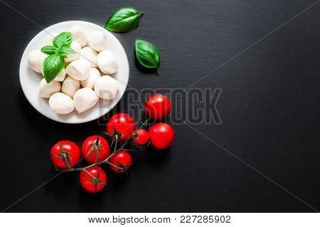 Organic Vegetarian Ingredients - Fresh Vegetables And Herbs Over Dark Chalk Board Background. Cherry