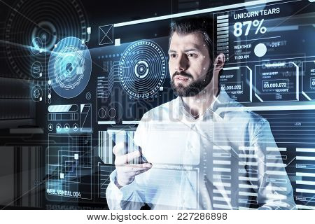 Concentration. Clever Experienced Qualified Programmer Feeling Concentrated While Standing In Front