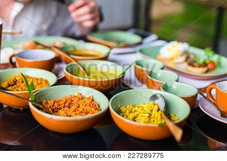 Coconut sambal and curry close up on table with Sri Lankan food