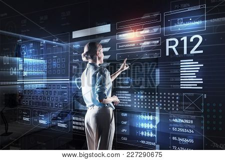 Saving Data. Calm Attentive Responsible Programmer Finishing Her Productive Working Day While Standi