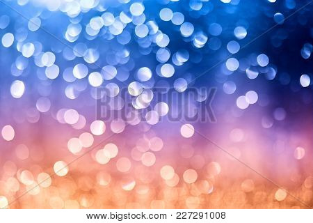 Defocused Of Light Blue, Pink And Orange Led Light On Black Background. Bokeh Photo Of Led Light. Bl