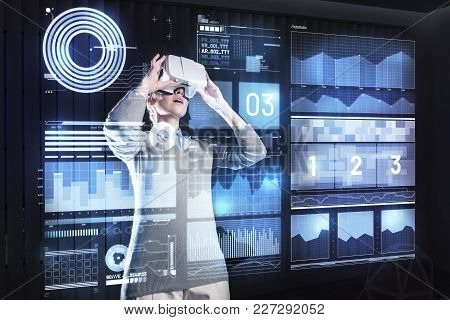 Feeling Surprised. Emotional Young Programmer Standing In Front Of A Futuristic Transparent Screen A