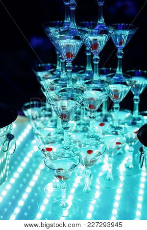 Glasses Of Sweet Martini With Cherry On An Aperitif For A Fun Party