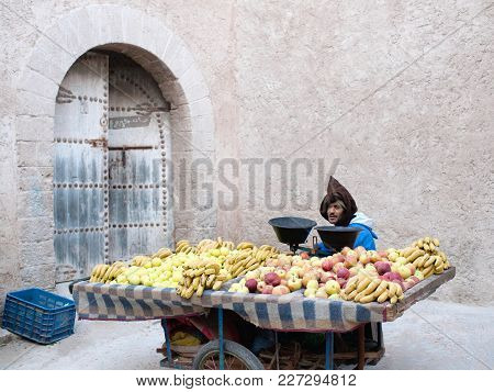 Essaouira, Morocco - January 14, 2014: Moroccan Street Vendor Selling Fruits On The Street In Essaou