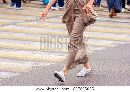 Young Woman Feet, Crossing An Urban Street On Summer Day