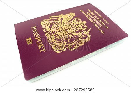United Kingdom / Uk British Passport On A White Background With Copy Space
