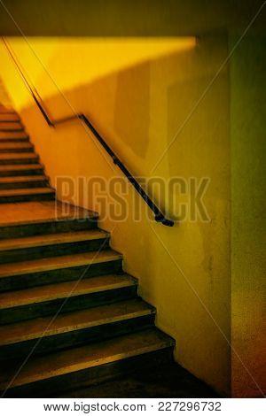 Yellow stairway in an underground passage way