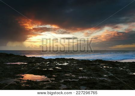 Carcavelos beach in Portugal in a cloudy winter evening