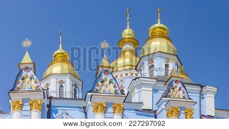 Top Part With Domes And Crosses Of A South Facade Of The Medieval Michael Golden-domed Cathedral Of