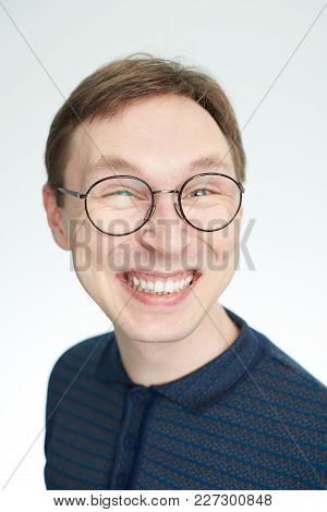 Laughing Face Of Young Man Isolated On White Background
