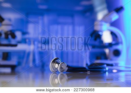 Medical Lab Concept. Science Research. Stethoscope And Microscope On Blue Background.