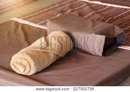Brown Towel And Pillow On Bed Decoration In Bedroom Interior