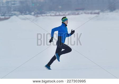 Male Athlete Running In Winter Outdoor, Sport And Leisure Concept