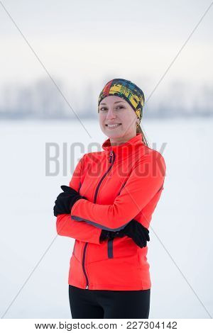 Portrait Of A Blonde Smiling Young Female Sportswoman In Winter Ice Field, Sport And Leisure Concept