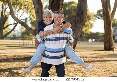 Portrait Of American Senior Beautiful And Happy Mature Couple Around 70 Years Old Showing Love And A