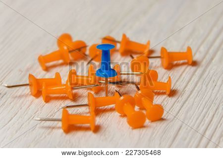 Stationary, Orange, Blue Pushpins Heap On White Wooden Background, Business Leadership Concept