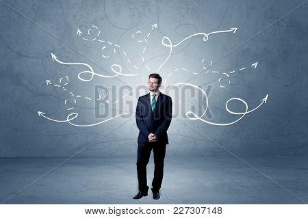 Elegant businessman choosing between directions with winding drawn arrows around