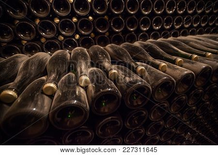 Interior Of Cellar With Bottles Of Old Bottles Of Champagne, In The Champagne Region, France.
